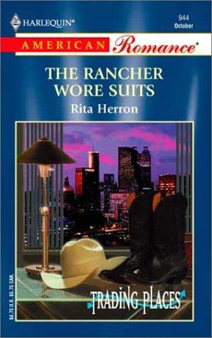 The Rancher Wore Suits by Rita Herron